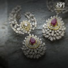 Stunning gold, diamonds eaarings with ruby residing at the centre.