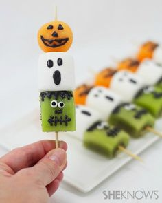 Frightful fruit kabobs - kiwi frankenstein, marshmellow ghost, cantaloupe Jacko'Lantern - can have the same design but use 2 candy coated marshmellows for Frankenstein and ghost and a Jacko'Lantern cake pop.