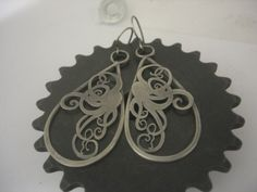 Hand cut with a tiny c-frame saw. the giant octopus earrings. Silver. www.brittanyjewelry.com