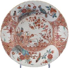 A pair of Chinese export porcelain plates with Dutch enamelled decoration. Yongzheng period. Chinese pair of plates, with a Dutch enamelled  decoration, in the Kakiemon style with birds, parrots and oriental themes.
