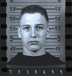 Paul Newman at age 18 having his mugshot taken while joining the Navy.