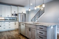 The oil rubbed bronze contrasts beautifully with the modern chrome appliances // Design by 303 Development Custom Homes, Denver, Chrome, Kitchen Cabinets, Appliances, King, Modern, Bronze, Design