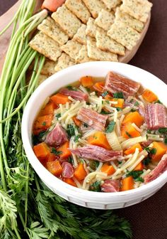 Don't throw away that ham bone when you're done with dinner. Save it, trim some ham off and make this Slow Cooker Ham Soup. Your family will thank you!