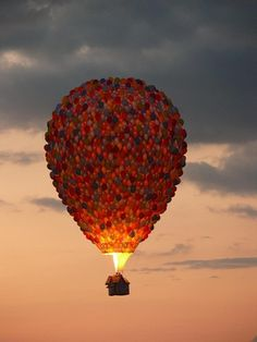 hot air balloon surrounded by balloons like up
