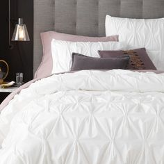 From West Elm's website: A west elm green product and a signature best-seller. Stitched in southern India, the unique and softly textured pintuck pleats of this organic cotton bedding create a voluminous, cloud-like look and feel with tons of texture.