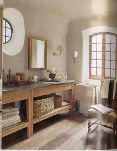 beach bathroom - slate/soapstone countertop , like open storage and basket texture