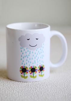 """From Rain Drops To Rainbows Mug 14.99 at shopruche.com. """"Take raindrops and turn them into rainbows."""" The perfect daily inspiration from this sweet ivory ceramic mug adorned with a colorful rain cloud and flower print. Dishwasher and microwave safe.Ceramic, 3.75"""" x 3.25"""""""