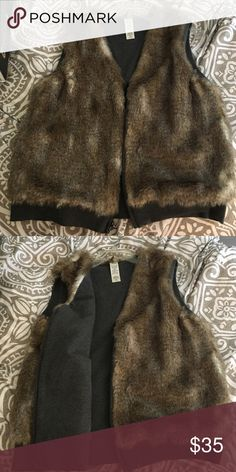 Faux fur reversible vest Super cute faux fur reversible vest from Splendid. Waist band and alternative side is a dark grey sweatshirt material. Worn once. Like new! Splendid Jackets & Coats Vests