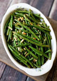 Green beans tossed with lemon, olive oil and spices roasted with slivered almonds until the beans are tender and caramelized.