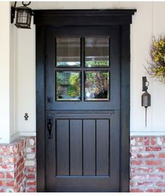 great front door! love the casing, shiplap top divider/glass, split in the middle -- paint it white