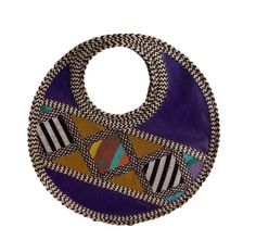 HAND-BAG MADE FROM WOVEN ARROW CANE, SYNTHETIC LEATHER & FABRIC WOVEN WITH A CIRCULAR SHAPE.