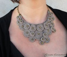 THIS NECKLACE IS RESERVED, please dont buy it! Thanks! :)    A cotton yarn crocheted necklace in clay color with spiral discs and bronze beads inserts. Bronze finish chain and clasp. Some of the discs are overlapped for a 3D effect. Very versatile, its perfect for both a casual or elegant outfit.  Very solid work!  One of a kind
