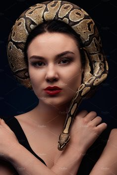 portrait of woman with snake by len4foto on @creativemarket