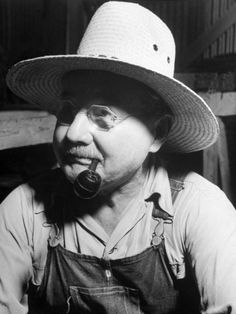 Farmer Wearing a Straw Hat, Glasses, Bib Overalls, and Smoking a Pipe Premium Photographic Print
