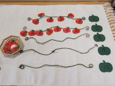 Pumpkins on a Vine - Use florist wire to create vines and painted wooden pumpkin cutouts as the numerals.  Place the corresponding numbers of pumpkins on each vine.