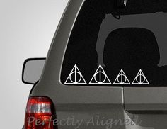 Deathly Hallow Family Car Decal. Finally, a good way to tell tailgaters how many nerds are in your car.