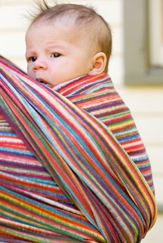 Breeze: Iris / The rich, earthy, and subtle rainbow stripes of Iris will compliment your wardrobe without being too bright. Iris is the winged goddess of the rainbow, said to move as swiftly as the wind. You, too, can get around as quickly as Iris when you carry your child in the subtle rainbow stripes of this carrier, moving unencumbered and with free hands. This much-loved Wrapsody is perfect for the person who loves lots of color.