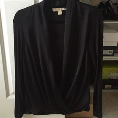Michael Kors black drapy top Beautiful MK black top only worn once. Middle of the blouse is a silk like material that drapes. Inside and on the sleeves is a cotton like material. Long sleeves. 95% rayon 5% spandex Michael Kors Tops