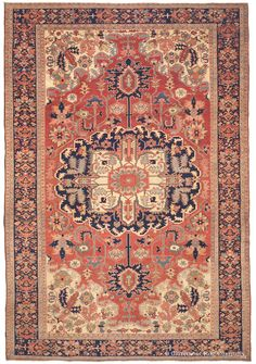Serapi, 9ft 8in x 14ft 7in, 3rd Quarter, 19th Century.  This uniquely sophisticated Serapi Oriental carpet offers the viewer a truly virtuoso artistic performance and is a true investment for an antique rug collector. A shimmering madder red reserve holds a singular medallion, adorned by stylized pendants, electric foliage and a magnificent inner cruciform in pure ivory. A mesmerizing collection of abstracted blossoms fill the field with the full spectrum of prized antique hues, including…