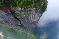 A glass walkway opened on Tianmen mountain, part of the latest addition to China's glass bridge craze. The 100m Coiling Dragon path is in Zhangjiajie National Forest Park in Hunan province.