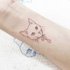 Illustrative style cat tattoo on the left wrist. Tattoo artist:...