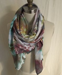 A personal favorite from my Etsy shop https://www.etsy.com/listing/384832426/earth-toned-shibori-tie-dye-square-scarf
