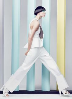 """Karlie Kloss in a Calvin Klein Collection stark white wrap vest, deep-cuffed """"unfinished"""" trousers, and sneaker sandals"""