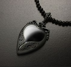 Black heart hematite necklace with an onyx chain by KAZNESQ