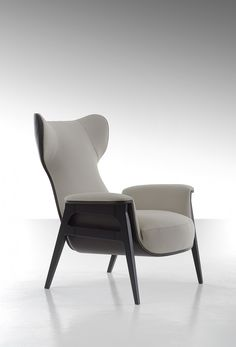 Fully upholstered with fabric or leather to give an even more deluxe silhouette, the ergonomics adjusted for more comfort that filled with Polyurethane and Fiberfill, the result is an elegant functional sculpture. Chair frame and legs are made of solid beech wood stained wengé.