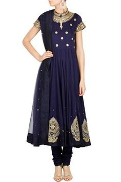 Featuring a midnight blue chinese collar cotton georgette anarkali with gold sequin and dori floral embroidery on bodice. It has dabka and sequin work multiple floral motifs around hemline. It is paired with a matching silk mulmul churidar. It comes along with a net dupatta with sequin scatter and polka dot dori bootis all over by AMBRISH DAMANI Shop now-www.carmaonlineshop.com