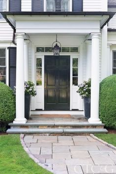 The home's traditional Colonial exterior is framed by a columned entry. Find even more entryway front porch decor inspiration at my webpage. The home's traditional Colonial exterior is framed by a columned entry. Colonial Front Door, House Front Door, House With Porch, Colonial House Exteriors, Colonial Exterior, Exterior Design, Portico Entry, Front Entry, Veranda Design