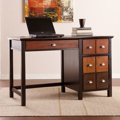 This Upton Home apothecary-esque desk features a rich espresso finish and multi-tonal wood hues to create a unique mission style. A fold down keyboard drawer and side cabinet effortlessly organize your work zone.
