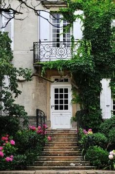 love the entrance.. no mention of location but w/French doors and balcony above the front door, it's just gotta be French!!!!