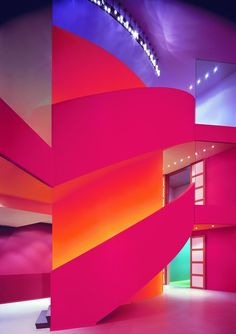 Groninger Museum, designed by Alessandro Mendini, The Netherlands.  Startling color surrounding walls and staircase.