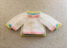 Ravelry: Tiny Topaz - Premature Baby Cardigan pattern by marianna mel Baby Cardigan Knitting Pattern Free, Baby Hats Knitting, Cardigan Pattern, Baby Knitting Patterns, Free Knitting, Crochet Patterns, Mittens Pattern, Knitting Needles, Baby Clothes Patterns
