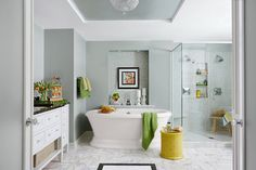 Reflective finishes and a new layout make the same-size space feel roomier and more luxurious, with touches like an air-bubble soaking tub and radiant floor heat timed to kick on at dawn. | Photo: Robert Trevis-Smith/Moment/Getty Images