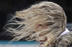 A wind gust blows the hair of a woman in her face in Frankfurt Main, Germany. Weather system called 'Xynthia' hit Germany with wind speeds of more than 100 km/h