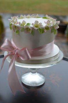 But a Dream Custom Cakes, palatiello on Cake Central.  Carrot cake with pearlized fondant and gum paste blossoms and leaves. These flowers are so delicate, I can hardly believe they are gum paste.