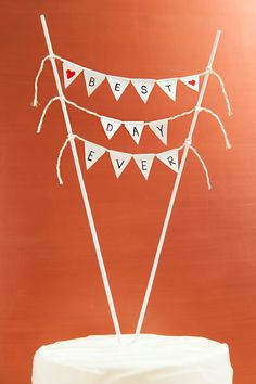 Check out this amazingly simple idea for making an adorable bunting style cake topper! Write ANY message you want!