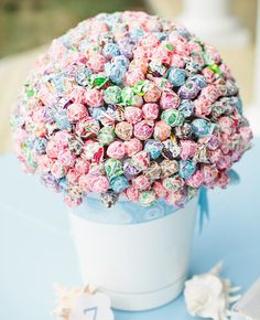 A Dum Dum Lollipop Centerpiece   10 Ideas That Prove You Don't Have to Take Your Wedding Too Seriously   https://www.theknot.com/content/10-ideas-that-prove-you-dont-have-to-take-your-wedding-too-seriously