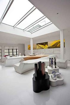 """Zaha Hadid's Clerkenwell Penthouse, London (purchased 2006)  Not built after her own design but rendered entirely her own, the penthouse of futuristic """"starchitect"""" Zaha Hadid in Clerkenwell is as much a gallery as it is a home, acting as the perfect stage for some of her boldest, avant-garde designs. Light plays an important role, courtesy of an enormous skylight that permeates the central seating area, and a wall of windows leading to the back terrace."""