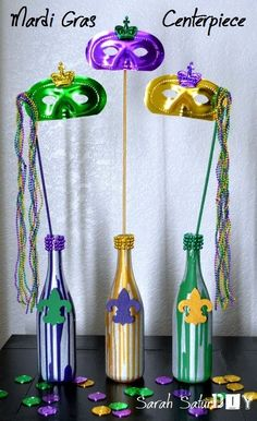 Easy DIY Mardi Gras centerpiece with painted wine bottles - so cute!