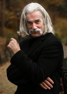 Sam Elliott ~ Born Samuel Pack Elliott August 9, 1944 (age 71) in Sacramento, California, US. American actor. His rangy physique, thick horseshoe moustache, deep, resonant voice, and Western drawl lend to frequent casting as cowboys and ranchers. His other credits over the years have included playing Marvel Comics characters General Ross in Hulk (2003), and The Caretaker in Ghost Rider (2007).