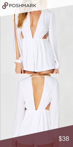 White Romper Great for summer, open back and v neck with fashionable slits on sleeve. Brand new Necessary Clothing Pants Jumpsuits & Rompers
