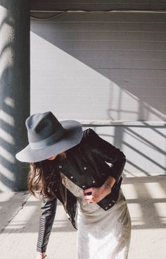 Great fall style: wide-brim hat, leather jacket, and a knit maxi dress.