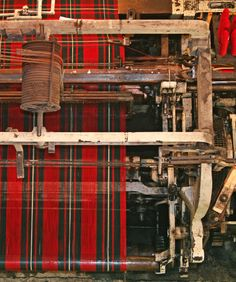 Overhead view of a mechanical loom making tartan.  Edinburgh.