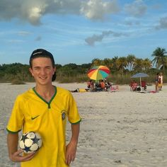 You're not in Ohio anymore. Outside. On the beach. In the sun.  #futbol #soccer #beach #outside #RTphotochallenge #umbrella #brazil #brasil #clouds #sky