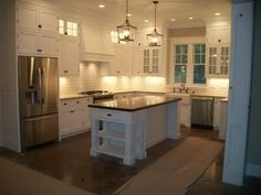 This kitchen has many layout similarities to our soon-to-be kitchen. Same d/w placement, fridge, range hood...