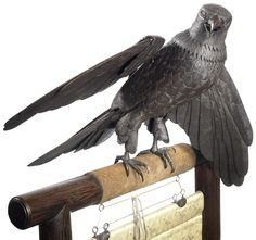 Japanese hawk of wrought iron made in the late 19th century. Fully articulated, its limbs and claws move; the head turns 180 degrees; the beak opens and closes; the neck, tail and wing feathers can be stretched out or shortened to mimic the animal at rest or in flight. There are only two other comparable hawks known to exist.