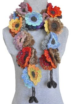 Crochet flower scarf. >>> That would be a nice scarf to wear in spring. I could make something like this!